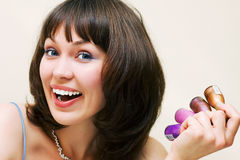 Happy woman with cosmetics Stock Images