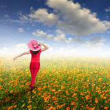 Happy woman  in cosmos flower field and blue sky Royalty Free Stock Image