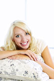 Happy woman on couch at home Royalty Free Stock Photo