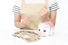Piggy bank with money Stock Photos