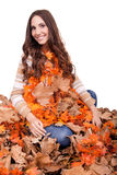 Happy woman covered with autumn leaves Royalty Free Stock Photos