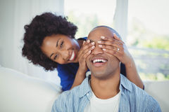 Happy Woman Covering Her Mans Eyes Royalty Free Stock Image