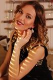 Happy woman in cozy xmas interior Royalty Free Stock Image