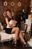 Happy woman in cozy xmas interior Royalty Free Stock Photography