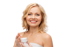 Happy woman with cream jar Royalty Free Stock Image