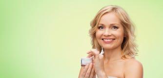 Happy woman with cream jar Royalty Free Stock Photos
