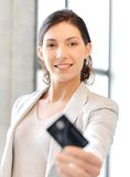 Happy woman with credit card Stock Photos