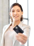 Happy woman with credit card. Bright picture of happy woman with credit card Royalty Free Stock Images