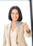 Happy woman with credit card Stock Image