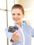 Happy woman with credit card Royalty Free Stock Photo