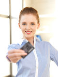Happy woman with credit card Royalty Free Stock Images