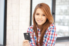 Happy woman with credit card. Bright picture of happy woman with credit card Royalty Free Stock Image