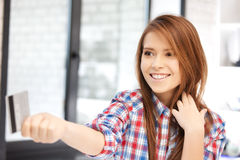 Happy woman with credit card. Bright picture of happy woman with credit card Royalty Free Stock Photography