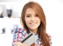 Happy woman with credit card Stock Images
