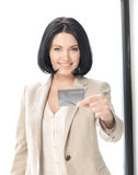 Happy woman with credit card Stock Photo