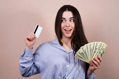 Happy woman with credit card and dollar bills royalty free stock photo
