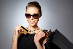 Happy woman with credit card and shopping bags Royalty Free Stock Images