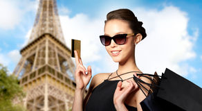 Happy woman with credit card and shopping bags Royalty Free Stock Photos