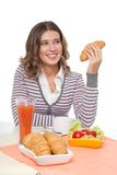 Happy woman with croissant Stock Photography