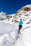 Happy woman cross country running in winter Royalty Free Stock Photography