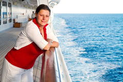 Happy woman on cruise ship Stock Photo
