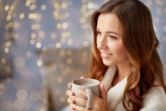 Happy woman with cup of cocoa or coffee at home Royalty Free Stock Photography