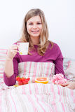 Happy woman with cup of coffee and breakfast Royalty Free Stock Photography