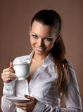 Happy woman with cup of coffee smile at brown Royalty Free Stock Images
