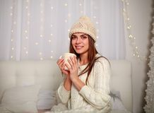 Happy woman with cup of coffee or tea at home in bedroom Royalty Free Stock Photography