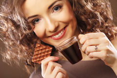 Happy woman with a cup of espresso coffee Stock Images