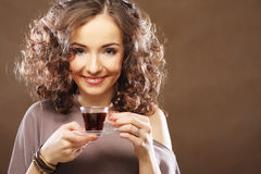 Happy woman with a cup of espresso coffee Stock Image