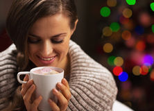 Happy woman with cup of hot chocolate with marshmallow Stock Images