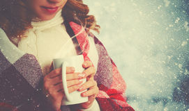 Happy woman with  cup of hot drink on cold winter outdoors Stock Image