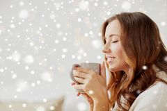 Happy woman with cup of tea or coffee at home Royalty Free Stock Photography