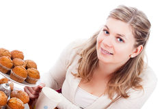 Happy woman with cup of tea and muffins. Beautiful happy young woman with cup of tea and sweet muffins,  on white background Royalty Free Stock Image