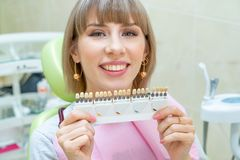 Happy woman customer in dentistry , teeth whitening royalty free stock images