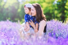 Happy woman with cute boy on lavender background. Mother Day. royalty free stock photos