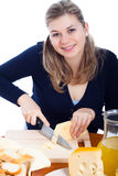 Happy woman cutting cheese Stock Image