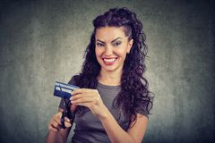 Happy woman cutting credit card Royalty Free Stock Photos