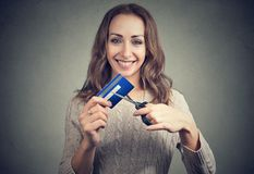 Happy woman cutting credit card Royalty Free Stock Photo
