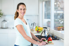 Free Happy Woman Cutting Cucumber Royalty Free Stock Image - 60554536