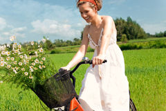 Happy woman on cycle ride in countryside Royalty Free Stock Image