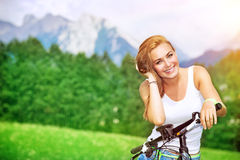 Happy woman cycling royalty free stock image