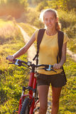 Happy woman cyclist Stock Photos