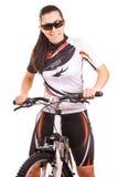 Happy woman cyclist on the bike in studio Stock Photo