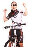 Happy woman cyclist on the bike in studio Royalty Free Stock Photography