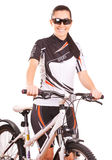 Happy woman cyclist on the bike in studio Royalty Free Stock Photos