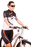 Happy woman cyclist on the bike in studio Stock Images