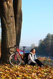 Happy woman cyclist enjoy the recreation autumn in nature Royalty Free Stock Images