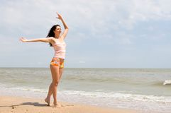 Happy woman dance on the beach Stock Photo